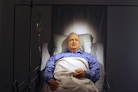 An art installation depicting former Israeli Prime Minister Ariel Sharon lying comatose in a hospital bed is displayed before it's official opening at the Kishon Gallery in Tel Aviv October 18, 2010. REUTERS/Nir Elias