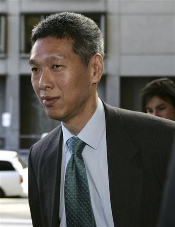 Then SingTel Chief Executive Lee Hsien Yang arrives at the Federal Court in Sydney in this April 5, 2006 file photo. REUTERS/Will Burgess/Files