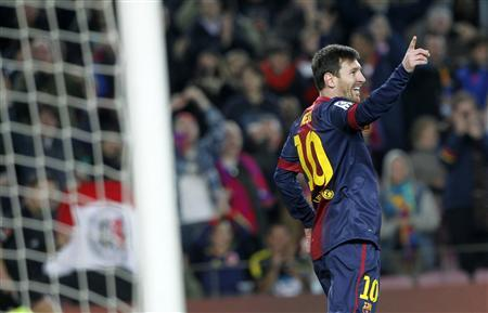 Barcelona's Lionel Messi celebrates a goal against Osasuna during their Spanish First division soccer league match at Camp Nou stadium in Barcelona, January 27, 2013. REUTERS/Albert Gea