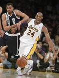 Oklahoma City Thunder shooting guard Thabo Sefolosha (2) knocks the ball away from Los Angeles Lakers shooting guard Kobe Bryant (24) to steal the ball during the first half of their NBA basketball game in Los Angeles, California January 27, 2013. REUTERS/Alex Gallardo
