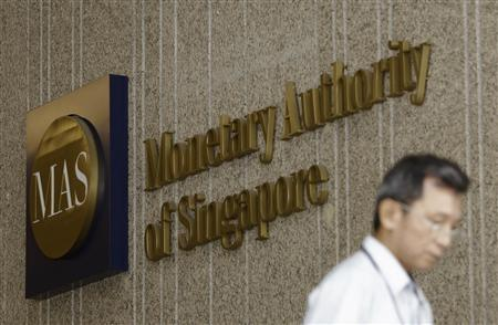 A man leaves the premises of the Monetary Authority of Singapore in the central business district of Singapore January 18, 2013. REUTERS/Edgar Su