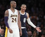 Oklahoma City Thunder guard Russell Westbrook (0) talks with Los Angeles Lakers guard Kobe Bryant (24), after a technical foul is called on Westbrook, during the second half of their NBA basketball game in Los Angeles, California January 27, 2013. REUTERS/Alex Gallardo