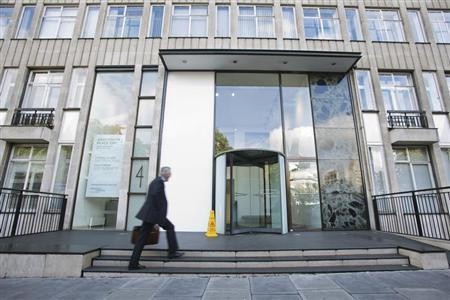A man walks into an office building that houses Bumi Plc in London September 25, 2012. REUTERS/Neil Hall