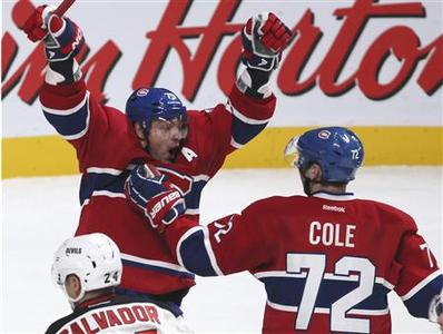 Montreal Canadiens' Andrei Markov (L) celebrates his game-winning goal with teammate Erik Cole (72) during overtime NHL hockey action against New Jersey Devils in Montreal, January 27, 2013. REUTERS/Christinne Muschi