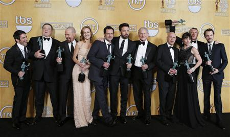 The cast of 'Argo' (L-R) Chris Messina, John Goodman, Bryan Cranston, Kerry Bishe, Rory Cochrane, Ben Affleck, Victor Garber, Alan Arkin, Clea DuVall, Tate Donovan and Christopher Denham hold their awards for outstanding performance by a cast in a motion picture for the film 'Argo' at the 19th annual Screen Actors Guild Awards in Los Angeles, California January 27, 2013. REUTERS/Adrees Latif