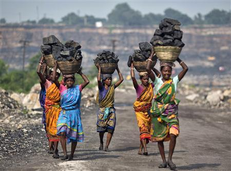 Local women carry coal taken from open cast coal field at Dhanbad district in Jharkhand September 19, 2012. REUTERS/Ahmad Masood/Files