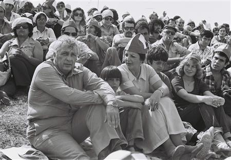Ariel Sharon (L) sits with his wife Lily (3rd L) and his sons, Gilad (2nd L) and Omri (4th L) during an event to launch his new political party, Shlomzion, in the West Bank in this picture taken in 1977. REUTERS/Dudu Grunshpan
