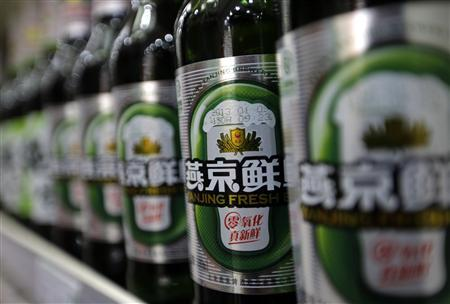 Bottles of Beijing Yanjing Brewery Co Ltd beer are displayed for sale at a supermarket in Beijing, January 26, 2013. REUTERS/Jason Lee