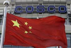 A Chinese national flag flies in front of COSCO's headquarters in Beijing August 26, 2010. REUTERS/Barry Huang
