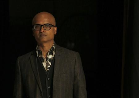 Jeet Thayil poses for photographers in London October 15, 2012. REUTERS/Luke MacGregor