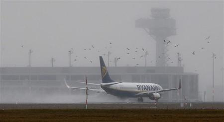 A Ryanair aircraft starts in front of the construction site of the future Berlin Brandenburg international airport Willy Brandt (BER) in Schoenefeld, January 9, 2013. REUTERS/Fabrizio Bensch