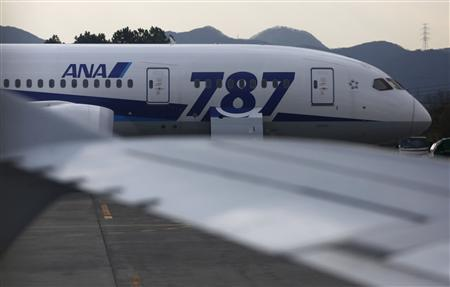 All Nippon Airways' (ANA) Boeing Co's 787 Dreamliner aircraft which made an emergency landing on January 16, is seen through a window of the ANA's Airbus A320 jet at Takamatsu airport in Takamatsu, western Japan in this January 19, 2013 file photo. REUTERS/Issei Kato/Files