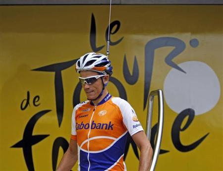 Rabobank rider Grischa Niermann of Germany arrives at the sign-in podium with a fake antenna on his helmet before the start of the tenth stage of the 96th Tour de France cycling race between Limoges and Issoudun, July 14, 2009. REUTERS/Bogdan Cristel
