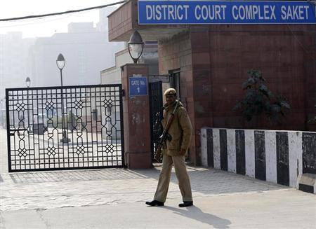 A policeman keeps guard outside a court in New Delhi January 7, 2013. REUTERS/Adnan Abidi