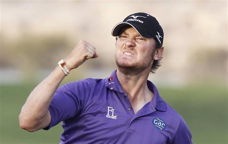 Chris Wood of England celebrates after his eagle putt on the 18th green during the final round of the Commercial Bank Qatar Masters at the Doha Golf Club January 26, 2013. REUTERS/Mohammed Dabbous