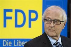 Parliamentary faction leader of the liberal Free Democratic Party (FDP) Rainer Bruederle attends a news conference where he is proposed as his party's top candidate in this year's general election at the FDP headquarters in Berlin, January 21, 2013. REUTERS/Thomas Peter (GERMANY - Tags: POLITICS ELECTIONS)