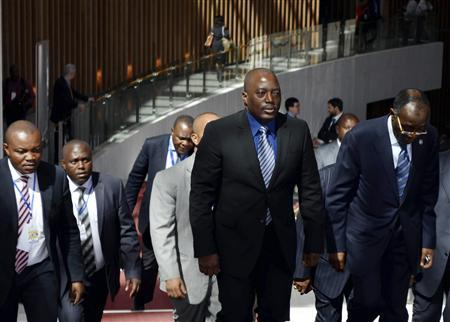 President of the Democratic Republic of Congo Joseph Kabila (2nd R) arrives at the venue for the 20th Assembly of the African Union (AU) at its headquarters in the Ethiopian capital Addis Ababa January 28, 2013. REUTERS/Tiksa Negeri