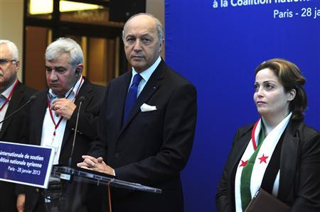 French Foreign Affairs Minister Laurent Fabius (C), Syrian Opposition Coalition vice-president Riad Seif (L) and member Suheir Atassi (R) attend a news conference during the international meeting to support the Syrian National Council in Paris, January 28, 2013. REUTERS/Stringer