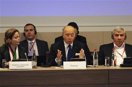 French Foreign Affairs Minister Laurent Fabius (C), Syrian Opposition Coalition vice-president Riad Seif (R) and member Suheir Atassi (L) attend the international meeting to support the Syrian National Council in Paris, January 28, 2013. REUTERS/Stringer
