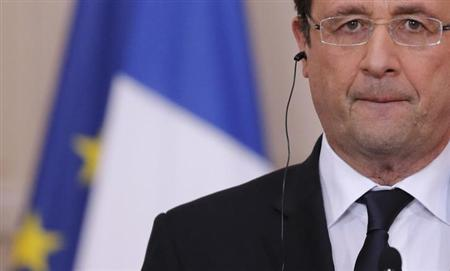 French President Francois Hollande attends a news conference at the Elysee Palace in Paris, January 28, 2013. REUTERS/Christian Hartmann