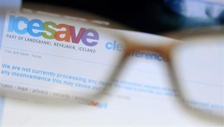 A page from icesave online bank is seen on a computer screen through a pair of glasses, in London October 7, 2008. REUTERS/Dylan Martinez