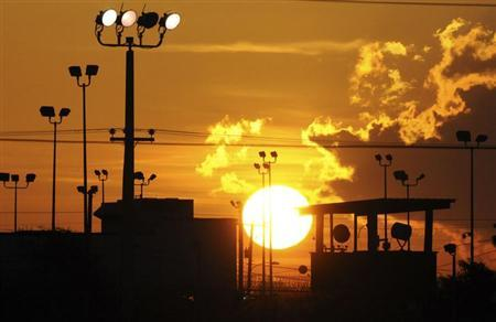 The sun rises over the U.S. detention center Camp Delta at US Naval Base Guantanamo Bay in Cuba on October 18, 2012 in this photo reviewed by the U.S. Department of Defense. REUTERS/Michelle Shephard/Pool