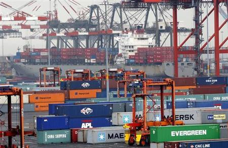 Ships and containers are seen at the Port Newark Container Terminal near New York City in Newark, New Jersey in this picture taken July 2, 2009. REUTERS/Mike Segar