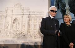 German designer Karl Lagerfeld (L) and Creative Director of Fendi, Silvia Fendi arrive to attend a news conference to present a project of cultural patronage that will involve Rome's Trevi fountain and others monuments, in Rome January 28, 2013. REUTERS/Tony Gentile