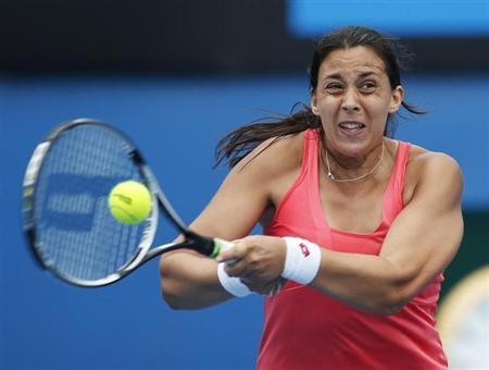 Marion Bartoli of France hits a return to Ekaterina Makarova of Russia during their women's singles match at the Australian Open tennis tournament in Melbourne, January 18, 2013. REUTERS/Daniel Munoz