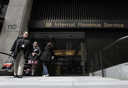 Women walk out of an Internal Revenue Service office in New York April 18, 2011. REUTERS/Lucas Jackson