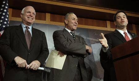 (L-R) U.S. Senators John McCain (R-AZ), Charles Schumer (D-NY), and Marco Rubio (R-FL) attend a news conference on comprehensive immigration reform at the U.S. Capitol in Washington January 28, 2013. REUTERS/Gary Cameron