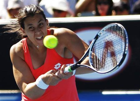 Marion Bartoli of France hits a return to Anabel Medina Garrigues of Spain during their women's singles match at the Australian Open tennis tournament in Melbourne January 14, 2013. REUTERS/Navesh Chitrakar