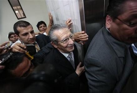 Former Guatemalan dictator Efrain Rios Montt (C) leaves the Supreme Court of Justice, after a judge announced the decision that Rios Montt will stand trial for genocide charges, in Guatemala City, January 28, 2013. REUTERS/Jorge Dan Lopez (GUATEMALA - Tags: POLITICS CRIME LAW)