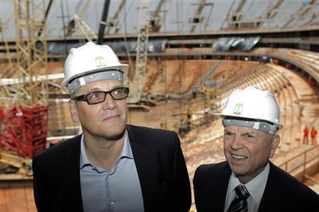 FIFA Secretary General Jerome Valcke (L) and Brazilian Football Confederation (CBF) President Jose Maria Marin visit the construction site of the National Stadium, which will host the 2014 World Cup, in Brasilia January 28, 2013. REUTERS/Ueslei Marcelino