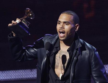 Chris Brown accepts the award for best R&B album for ''F.A.M.E.'' at the 54th annual Grammy Awards in Los Angeles, California, February 12, 2012. REUTERS/Mario Anzuoni