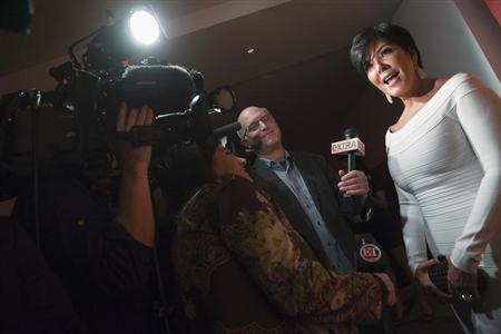 TV personality Kris Jenner (R) talks with reporters as she arrives for a party thrown by Google and the Hollywood Reporter, on the eve of the annual White House Correspondents' Association Dinner, at the W Hotel in Washington, April 27, 2012. REUTERS/Jonathan Ernst