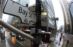 """A Bay Street sign, the main street in the financial district is seen in Toronto, January 28, 2013. Moody's Investors Service has cut the ratings of six Canadian financial institutions, including the previously """"Aaa"""" rated Toronto-Dominion Bank, due to concerns about rising consumer debt and high housing prices. TD, the only publicly traded bank that still carried Moody's top rating, was downgraded, along with Bank of Nova Scotia , Canadian Imperial Bank of Commerce, Bank of Montreal, National Bank of Canada and Caisse Central Desjardins, Canada's largest association of credit unions, Moody's said on Monday. REUTERS/Mark Blinch"""