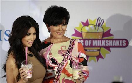 TV personality Kim Kardashian (L) poses with her mother Kris Jenner during a news conference in Dubai October 13, 2011. REUTERS/Jumana El Heloueh/Files