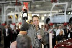 Tesla Chief Executive Office Elon Musk celebrates at his company's factory in Fremont, California, June 22, 2012, as the car company began delivering its Model S electric sedan. REUTERS/Noah Berger