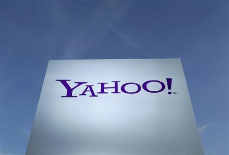 A Yahoo logo is pictured in Rolle, 30 km (19 miles) east of Geneva, December 12, 2012. REUTERS/Denis Balibouse/Files