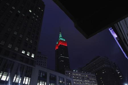 The Empire State Building is lit up in red and green on Christmas day in New York December 25, 2012. REUTERS/Eduardo Munoz