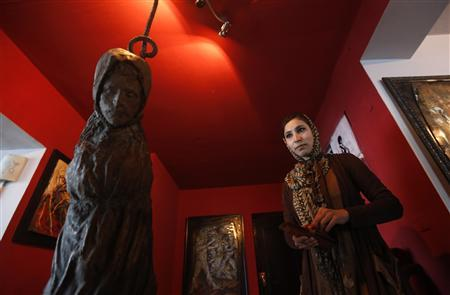 Afghan artist Malina Suliman is pictured inside The Venue art gallery in Kabul December 2, 2012. REUTERS/Mohammad Ismail