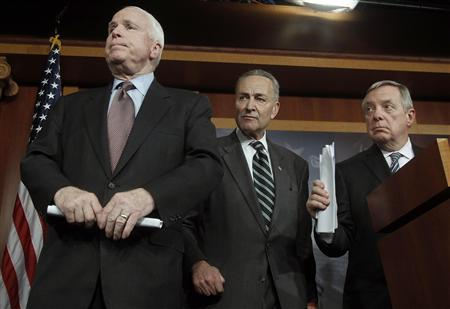 (R-L) U.S. Senator Richard Durbin (D-IL), Senator Charles Schumer (D-NY) and Senator John McCain (R-AZ) listen to a question at a news conference on comprehensive immigration reform at the U.S. Capitol in Washington January 28, 2013. REUTERS/Gary Cameron