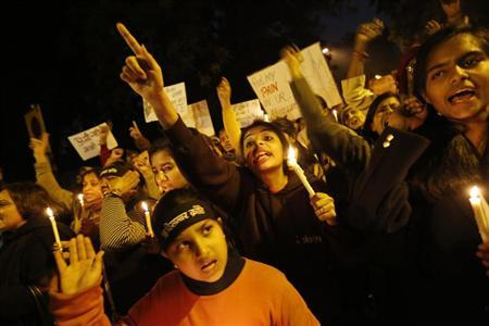 Demonstrators shout slogans and raise their hands during a candlelight march for a gang rape victim, who was assaulted in New Delhi January 16, 2013. REUTERS/Adnan Abidi