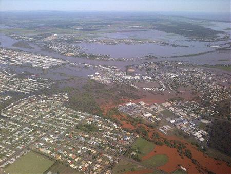 Floodwaters from the Burnett River inundate parts of Bundaberg, 300kms (186 miles) north of Brisbane January 29, 2013 in this handout picture made available by the Queensland Premier's office. REUTERS/Campbell Newman/Office of the Premier of Queensland/Handout