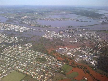 Floodwaters from the Burnett River inundate parts of Bundaberg, 300kms north of Brisbane January 29, 2013 in this handout picture made available by the Queensland Premier's office. REUTERS/Campbell Newman/Office of the Premier of Queensland/Handout