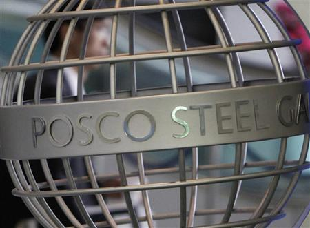 An employee of steelmaker POSCO walks at the company's headquarters in Seoul April 10, 2009. REUTERS/Lee Jae-Won/Files`