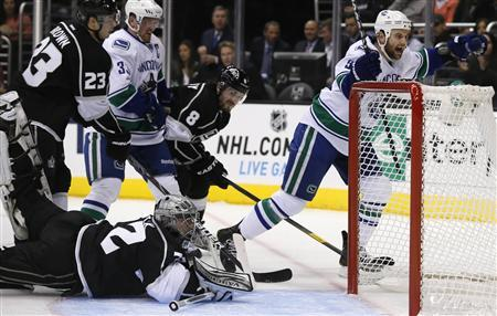 Vancouver Canucks' Zack Kassian (R) scores past Los Angeles Kings goaltender Jonathan Quick (bottom) during the first period of their NHL game in Los Angeles, California, January 28, 2013. REUTERS/Lucy Nicholson