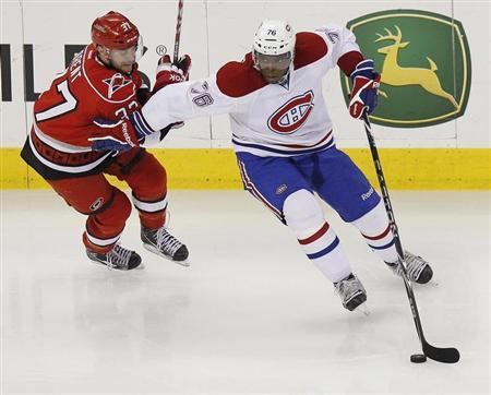 The Montreal Canadiens' P.K. Subban (R) battles the Carolina Hurricanes' Tim Brent for the puck during their NHL hockey game in Raleigh, North Carolina April 5, 2012. REUTERS/Ellen Ozier