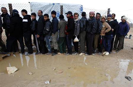 Syrian refugees wait to receive humanitarian aid during a visit by Anne C. Richard, assistant secretary of state for population, refugees, and migration, and Nancy Lindborg (both not pictured), USAID assistant administrator for democracy, conflict, and humanitarian assistance, at the Al Zaatri Syrian refugee camp in the Jordanian city of Mafraq, near the border with Syria January 28, 2013. REUTERS/Ali Jarekji